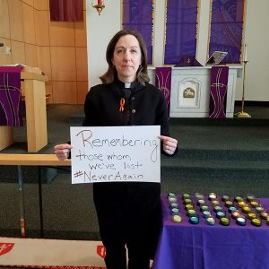 Pastor Cathy with #NeverAgain Sign